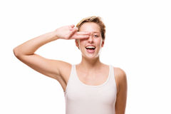 Happy woman holding fingers over her eye Stock Photography