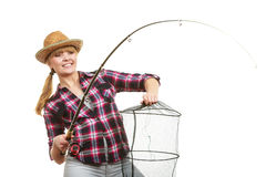 Happy woman holding fishing rod and keepnet Stock Photography