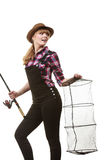 Happy woman holding fishing rod and keepnet. Spinning, angling, cheerful fisherwoman concept. Happy woman in sun hat holding fishing rod and keepnet having fun stock images