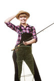 Happy woman holding fishing rod and keepnet. Spinning, angling, cheerful fisherwoman concept. Happy woman in sun hat holding fishing rod and keepnet having fun royalty free stock photography