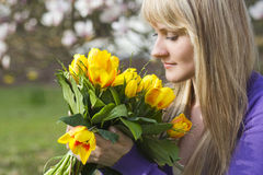 Happy woman holding flowers Stock Photos