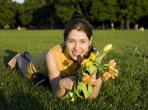 Happy woman holding flowers meeting friend Royalty Free Stock Images