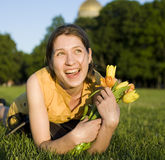 Happy woman holding flowers meeting friend Stock Images
