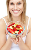 Happy woman holding a fruit salad Stock Photography