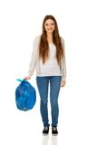 Happy woman holding a full garbage bag. Stock Image