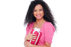 Happy woman holding gift. Isolated on white background Stock Photography