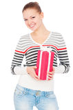 Happy woman holding gift. Isolated on white background Royalty Free Stock Image