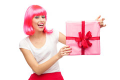 Happy woman holding gift. Happy young woman holding gift Royalty Free Stock Photo