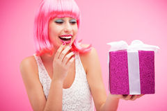 Happy woman holding gift Royalty Free Stock Photography