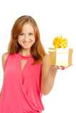 Happy woman holding a gift box. White background Stock Photos