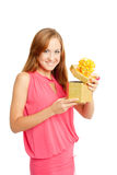 Happy woman holding a gift box. White background Royalty Free Stock Photography