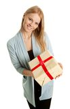 Happy woman holding gift box. Isolated on white Royalty Free Stock Images