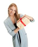 Happy woman holding gift box. Isolated on white Royalty Free Stock Photo