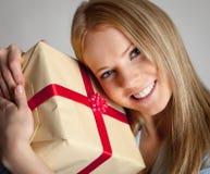 Happy woman holding gift box. Happy beautiful young woman holding gift box Royalty Free Stock Image