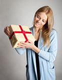 Happy woman holding gift box Royalty Free Stock Photo
