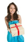 Happy woman holding gift box. Isolated on white Stock Image