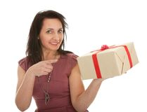 Happy woman holding gift box. Isolated on white Stock Photography