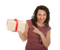 Happy woman holding gift box. Isolated on white Stock Photo