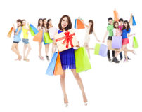 Happy woman holding a gift box and color bags. Happy women holding a gift box and color bags with shopping friends.isolated on white background Royalty Free Stock Photography