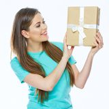 Happy woman holding gift box. Smiling girl with long hir Royalty Free Stock Image