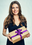Happy woman holding gift box. Royalty Free Stock Photography