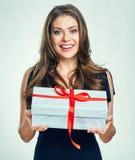 Happy woman holding gift box. Royalty Free Stock Photos
