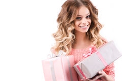 Happy woman holding gift box. Royalty Free Stock Image