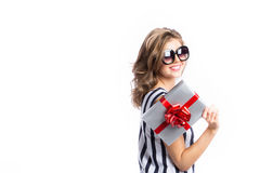 Happy woman holding gift box, isolated on white background. Royalty Free Stock Image
