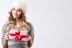 Happy woman holding gift box, isolated on white background. Royalty Free Stock Photos
