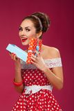 Happy Woman Holding Gift Box. Pin-up retro style Royalty Free Stock Photos