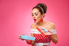 Happy Woman Holding Gift Box. Pin-up retro style Royalty Free Stock Photo
