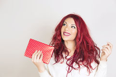 Happy woman holding a gift box. Royalty Free Stock Photography