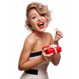 Happy Woman holding Gift Box. White background Stock Photography
