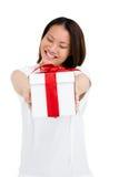 Happy woman holding gift box Royalty Free Stock Photo