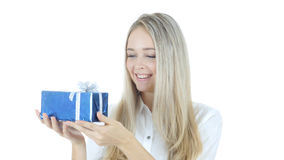 Happy Woman Holding Gift Box , White Background Royalty Free Stock Photography