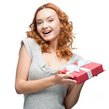 Happy woman holding gift. Caucasian red happy woman holding red gift isolated on white Stock Photography