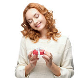 Happy woman holding gift. Caucasian red happy woman holding red gift isolated on white Royalty Free Stock Photos