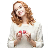 Happy woman holding gift. Caucasian red happy woman holding red gift isolated on white Royalty Free Stock Photography