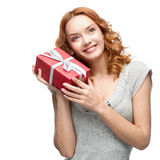 Happy woman holding gift. Caucasian red happy woman holding red gift isolated on white Royalty Free Stock Photo