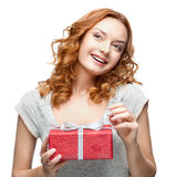 Happy woman holding gift. Caucasian red happy woman holding red gift isolated on white Royalty Free Stock Images