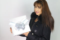 Happy woman holding a gift Royalty Free Stock Image