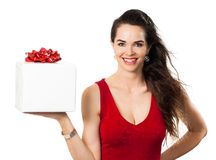 A happy woman holding a gift Stock Image
