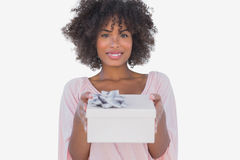 Happy woman holding a gift. On white background Royalty Free Stock Photo