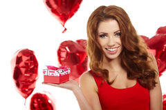 Happy woman holding gift. Happy young woman holding gift Royalty Free Stock Images