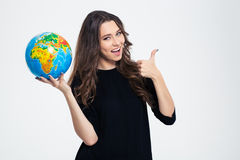 Happy Woman Holding Globe And Showing Thumb Up Royalty Free Stock Photo