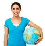 Happy Woman Holding Globe Stock Image