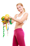 Happy woman holding grapefruits and tape measures. Stock Photography