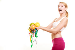 Happy woman holding grapefruits and tape measures. Royalty Free Stock Image