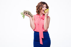 Happy woman holding grapes and eating pear Royalty Free Stock Images