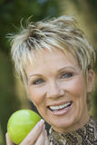 Happy Woman Holding Green Apple Royalty Free Stock Images